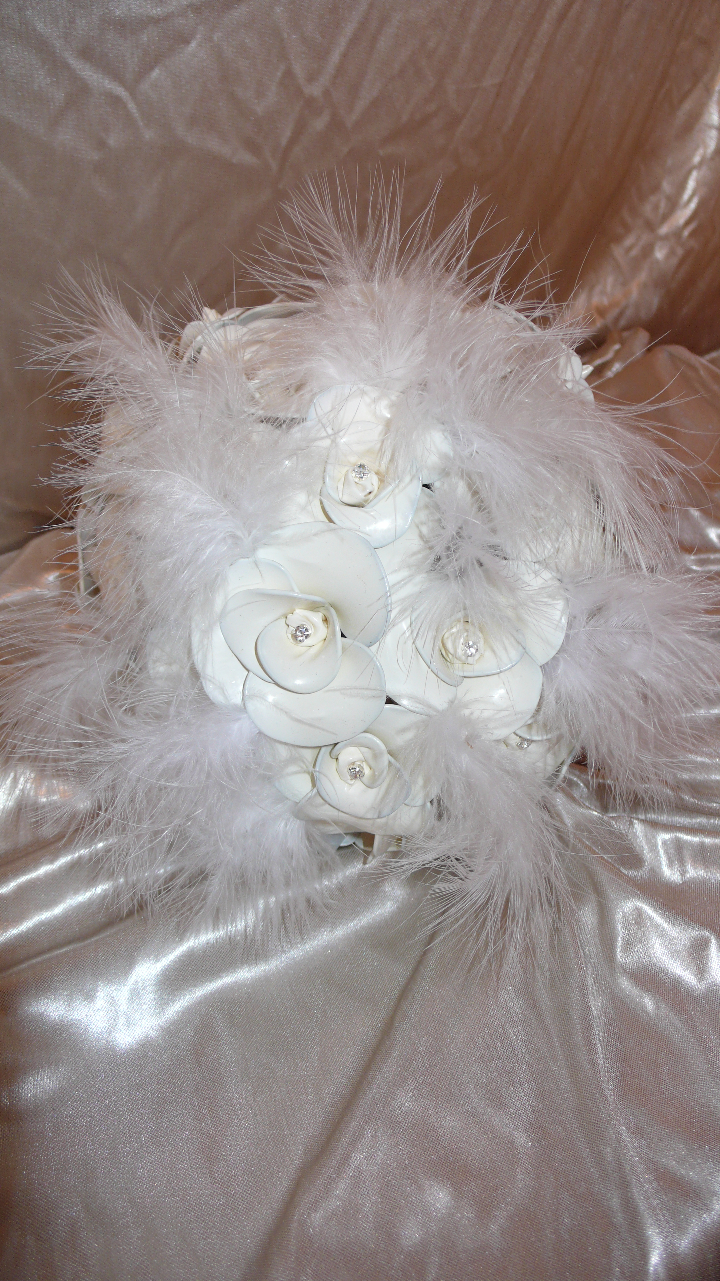 A bit of fun added in the form of soft white feathers to a fantasy bouquet